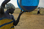 Women at work in the Namokora camp for internally displaced persons in northern Uganda.