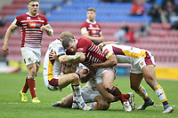 Wigan Warriors' Tony Clubb is tackled by  Huddersfield Giants' Ryan Hinchcliffe, Kruise Leeming and Sebastine Ikahihifo <br /> Photographer Stephen White/CameraSport<br /> <br /> Betfred Super League Round 5 - Wigan Warriors v Huddersfield Giants - Sunday 19th March 2017 - DW Stadium - Wigan<br /> <br /> World Copyright &copy; 2017 CameraSport. All rights reserved. 43 Linden Ave. Countesthorpe. Leicester. England. LE8 5PG - Tel: +44 (0) 116 277 4147 - admin@camerasport.com - www.camerasport.com