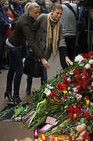 Moscow, Russia, 30/03/2010..A woman weeps as she lays flowers at a makeshift shrine on the spot inside Lubyanka metro station where a female suicide bomber blew herself up the previous day. At least 39 people were killed and 80 injured in the double blasts at Moscow metro stations during the morning rush hour.