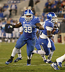 Kentucky Wildcats fullback Darrell Warren (39) defends the ball held by Kentucky Wildcats running back Dyshawn Mobley (33) during the second half of the UK Football game v. Samford at Commonwealth Stadium in Lexington, Ky., on Saturday, November 17, 2012. Photo by Genevieve Adams | Staff