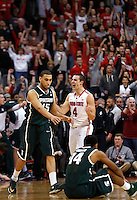 Michigan State Spartans guard Denzel Valentine (45) goes to help up Michigan State Spartans guard Gary Harris (14) as Ohio State Buckeyes guard Aaron Craft (4) reacts as the final seconds tick off in the second half of the NCAA men's basketball game between the Ohio State Buckeyes and the Michigan State Spartans at Value City Arena in Columbus, Ohio, Sunday afternoon, March 9, 2014. The Ohio State Buckeyes defeated the Michigan State Spartans 69 - 67. (The Columbus Dispatch / Eamon Queeney)