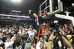 Ole Miss head coach Andy Kennedy cuts down the net following a win vs. Florida in the SEC championship game at Bridgestone Arena in Nashville, Tenn. on Sunday, March 17, 2013. Ole Miss won 66-63.