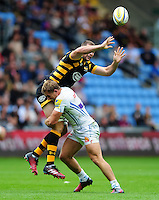 Matt Symons of Wasps passes the ball out of a tackle. Aviva Premiership match, between Wasps and Exeter Chiefs on September 4, 2016 at the Ricoh Arena in Coventry, England. Photo by: Patrick Khachfe / JMP
