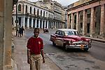 _SM16881, Havana, Cuba, 12/2010, CUBA-10024. Young man walking down the street. <br /> <br /> retouched_Ekaterina Savtsova 11/07/2014