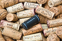 Traditional wine bottle corks with new-style modern plastic stopper