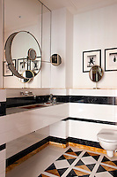 This bathroom is decorated with an Eileen Gray Satellite mirror and framed photographs by Philip Halsman