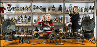 BNPS.co.uk (01202 558833)<br /> Pic: TomWren/BNPS<br /> <br /> Pamela Barnes (centre) and Cottees auctioneer Nell Hilditch with the collection of lamps.<br /> <br /> This is the 'Lady with the Lamp' whose impressive collection of 400 historic lamps has emerged for auction and is tipped to sell for &pound;10,000.<br /> <br /> Pamela Barnes and her husband Kenneth have amassed a remarkable haul of 19th and 20th century railway, naval and mining lamps.<br /> <br /> It all started 50 years ago when Mr Barnes, 90, gave up smoking and decided he needed another 'bad habit'. <br /> <br /> The couple picked up the lamps at second hand shops and would take them in their caravan to rallies across the south of England.