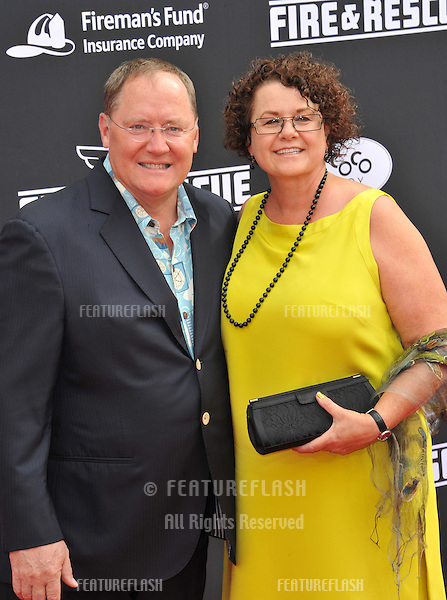 Executive producer John Lasseter &amp; wife Nancy at the world premiere of his movie Disney's &quot;Planes: Fire &amp; Rescue&quot; at the El Capitan Theatre, Hollywood.<br /> July 15, 2014  Los Angeles, CA<br /> Picture: Paul Smith / Featureflash