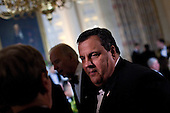 Governor Chris Christie (Republican of New Jersey) speaks with guests in the State Dining Room of the White House February 26, 2012 in Washington, DC.  President Obama and first lady Michelle Obama hosted 2012 Governors Dinner which coincides with the yearly meeting of the National Governors Association meeting in DC. .Credit: Brendan Smialowski / Pool via CNP