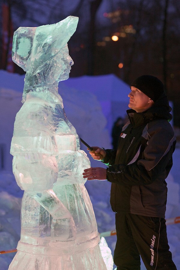Moscow, Russia, 14/01/2012..A sculptor at work in Moroz City, or Frost City, an ice town constructed in Moscow&rsquo;s Sokolniki Park by a team of architects and ice sculptors. As well as ice sculptures the temporary town features a disco, hotel, fitness centre, post office and prison.
