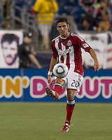 Chivas USA defender Zarek Valentin (20) passes the ball. In a Major League Soccer (MLS) match, Chivas USA defeated the New England Revolution, 3-2, at Gillette Stadium on August 6, 2011.