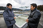 Takeshi Tachibana (L) and Hiromitsu Ito of Oh! Guts! stand next to some of the equipment that the company has maanaged to salvage in Ogatsu, Ishinomaki, Miyagi Prefecture, Japan on 01 Dec 2011. .Photographer: Robert Gilhooly