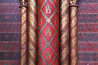 Detail of columns decorated with golden Castilian castles with red background, lower chapel of La Sainte-Chapelle (The Holy Chapel), 1248, Paris, France. The Castilian castles symbolize Blanche de Castille, Saint Louis' mother. La Sainte-Chapelle was commissioned by King Louis IX of France to house Saint Louis' collection of Passion Relics, including the Crown of Thorns, and is considered among the highest achievements of the Rayonnant period of Gothic architecture. Picture by Manuel Cohen