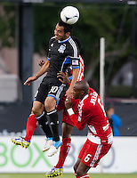 Santa Clara, California - Saturday July 18, 2012: FC Dallas' Jackson Goncalves fights for a jump ball with San Jose Earthquakes' Rafael Baca during a game at Buck Shaw Stadium, Stanford, Ca   San Jose Earthquakes defeated FC Dallas 2 - 1.