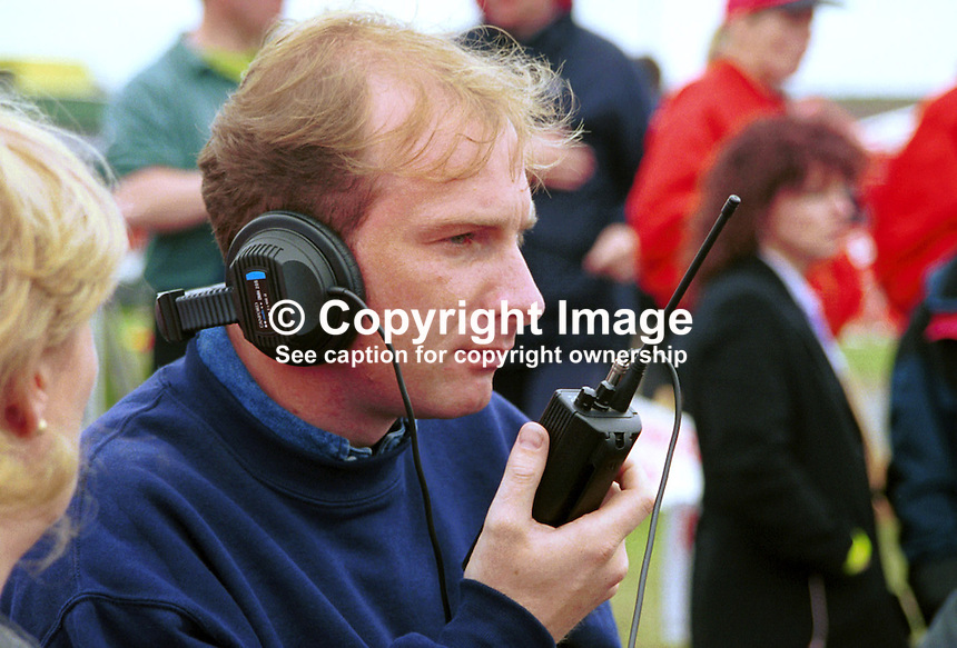 Stephen Watson, sports presenter, Ulster Television, N Ireland. Ref: 199805033, Picture taken 16 May 1998 at NW200 Motorcycle Races, Coleraine, N Ireland...Copyright Image from Victor Patterson, 54 Dorchester Park, Belfast, UK, BT9 6RJ..Tel: +44 28 9066 1296.Mob: +44 7802 353836.Voicemail +44 20 8816 7153.Skype: victorpattersonbelfast.Email: victorpatterson@mac.com.Email: victorpatterson@ireland.com (back-up)..IMPORTANT: If you wish to use this image or any other of my images please go to www.victorpatterson.com and click on the Terms & Conditions. Then contact me by email or phone with the reference number(s) of the image(s) concerned.