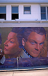 Mural painted on a side of building depicting stars of old Hollywood, along street Hollywood Los Angeles California USA