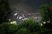 Ambulance personell tend to wounded on the mainland side, near Utoya island. Picture is taken shortly after the massacre.<br /> <br /> <br /> Oslo 20110722 Massakre p&aring; Ut&oslash;ya. Dette bildet er ikke fra &oslash;ya, men fra landsiden. Bildet er tatt like etter at politiaksjonen var over. 22. juli FOTO: ADRIAN &Oslash;HRN JOHANSEN