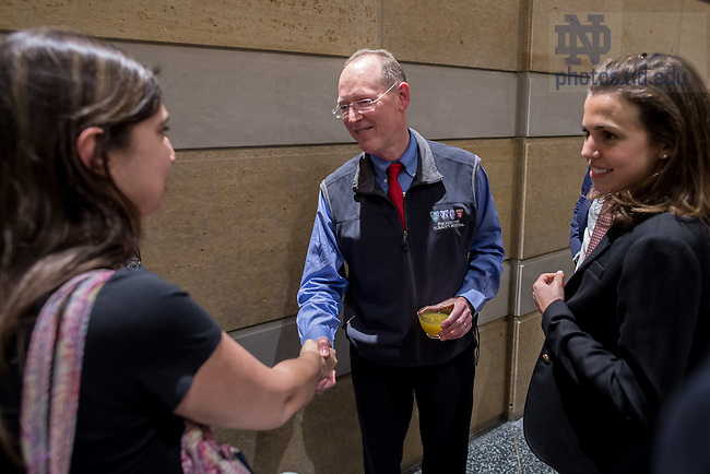 Apr. 19, 2016; Dr. Paul Farmer, cofounder of Partners In Health and chair of the Department of Global Health and Social Medicine at Harvard Medical School, speaks with students at a reception following a public lecture hosted by the Notre Dame Kellogg Institute for International Studies. (Photo by Matt Cashore/University of Notre Dame)