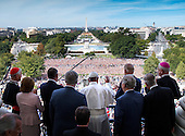 His Holiness Pope Francis waves to the crowd from the Speakers Balcony at the US Capitol with members of congress, Thursday, Sept. 24, 2015.<br /> Credit: Doug Mills / Pool via CNP