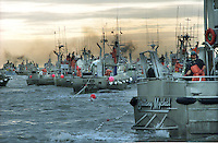 Gillnet fishing boats fish for sockeye salmon on the North Line fishing boundary of Egegik River in Bristol Bay, Alaska in July 1996.