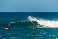 North Shore, Oahu, Hawaii (Sunday, Dec. 1, 2013) .-- Hawaii's own Ezekiel Lau, 20, posted the largest victory of his young career today by winning the prestigious 39th annual VANS World Cup of Surfing at Sunset Beach - the second stop of the Vans Triple Crown of Surfing. Lau's win earned him $40,000 and sees him close the year at 35th position on the ASP world rankings. While that doesn't qualify him for next year's elite World Championship Tour, it does guarantee him an excellent seed. He also holds a shared lead on the coveted Vans Triple Crown series rankings with Michel Bourez (PYF) heading into the third and final event of the series - the Billabong Pipe Masters, where he is a local wildard entry.<br /> <br /> Lau made a late tube-riding charge from behind to turn the tables on Damien Hobgood (USA) and Raoni Monteiro (BRA) in the latter half of the 30-minute final. Fourth place was Frederico Morais, (PRT), who was announced the JN Chevrolet Rookie of the 2013 Vans Triple Crown. Lau went on the hunt and found his way onto the biggest waves of the final that also offered high-scoring tube riding potential. His final scoreline was 15.5 points out of 20 (8.67 and 6.83 point rides). Hobgood was second on 14.3; Monteiro third with 12.33, and Morais on 7.16.Photo: joliphotos.com