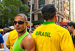 NEW YORK: AUGUST 31: Two young men in crowd at 24th annual Brazilian Day Festival August 31, 2008 on 46th St., in Little Brazil, near Times Square, NYC. Looking at camera, one boy wearing green tank top, and one seen from back wearing yellow and green shirt with Brazil on back. Brazilians worldwide came to proudly share their cultural heritage.
