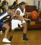 WATERBURY, CT,  02 JANUARY 2006, 010207BZ08- Sacred Heart's Chanel Ward (23) drives past Kennedy's Devondra Riddick (11) during their game at Sacred Heart High School in Waterbury Tuesday.<br /> Jamison C. Bazinet Republican-American