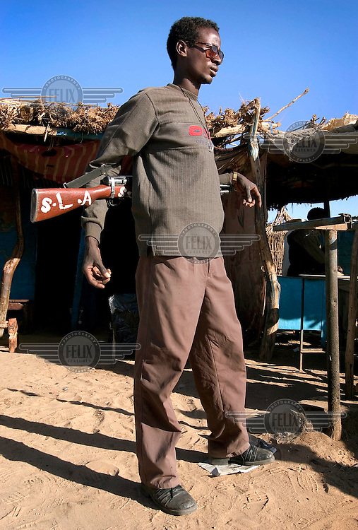 A Sudanese Liberation Army (SLA) soldier in the market.