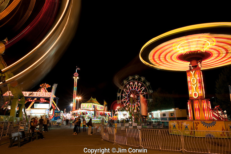 Evergreen State Fair people enjoying the amusement rides and game booths at night Monroe Washington State USA