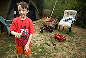 "Nine-year-old Stanley Bryant enjoys camping out in the backyard of the family's home inside the ""country quiet"" Homestead Village mobile home park North of Raleigh off Capitol Boulevard. His mother, Kay Bryant, said that he has been really upset about the possibility of leaving the only place he?s ever called home.  ..."
