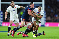 Jonathan Joseph of England takes on the France defence. RBS Six Nations match between England and France on February 4, 2017 at Twickenham Stadium in London, England. Photo by: Patrick Khachfe / Onside Images