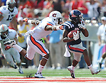 Mississippi running back Jeff Scott (3) is chased by Auburn defensive back Jermaine Whitehead (9) at Vaught-Hemingway Stadium in Oxford, Miss. on Saturday, October 13, 2012. (AP Photo/Oxford Eagle, Bruce Newman)..
