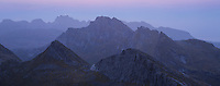 Twilight view over mountain landscape from summit of Markan (600m), Moskenesøy, Lofoten Islands, Norway