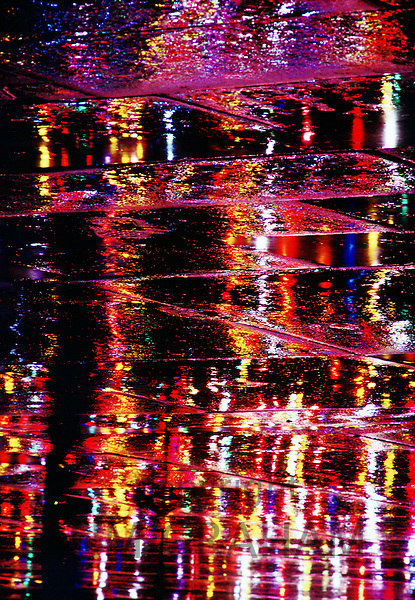 City lights reflecting on wet paving stones, Trafalgar Square, London, United Kingdom.