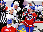 6 February 2010: Montreal Canadiens' rookie center Ryan White (53) gets into a scuffle with Pittsburgh Penguins right wing forward Craig Adams  during a game at the Bell Centre in Montreal, Quebec, Canada. The Canadiens defeated the Penguins 5-3. Mandatory Credit: Ed Wolfstein Photo