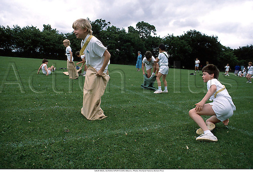 Young boys compete in a sack race at school sports day, 880711. Photo: Richard Francis/Action Plus...1988.child.children.kids kid.boy.boys.Youngster.Youngsters.childrens sport.children's sport