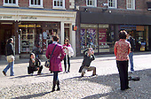 Tourists taking photos of themselves at Trinity College, Cambridge.
