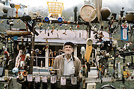 Seth, West Virginia, U.S.A, December, 1980. America severly marked by the recession. Mr Gamehaw Kessinger selling various things in front of his house.