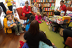 SFMOMA Education Associate for Family Programs reads books about art to local families during a Family Art Day at Linden Tree Books in Los Altos.
