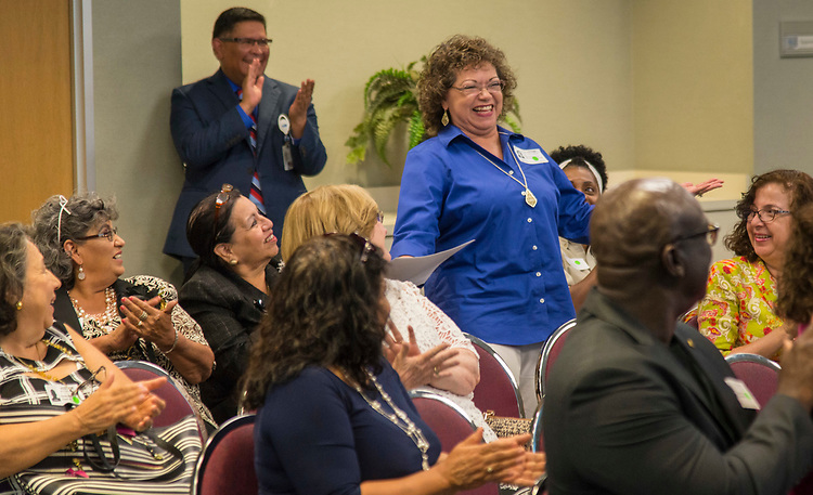 Gloria Salazar is recognized for 40 years of service during a Retiree Reception at Hattie Mae White, May 11, 2017.