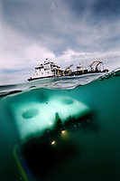 A remotely operated vehicle (ROV) is lowered into the water from the research ship Cehili. The ROV was investigating a site where marine archeologists had discovered a two hundred year old shipwreck.