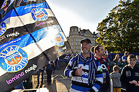 A Bath fan waves a giant flag in support during the pre-match warm-up. West Country Challenge Cup match, between Bath Rugby and Gloucester Rugby on September 26, 2015 at the Recreation Ground in Bath, England. Photo by: Patrick Khachfe / Onside Images
