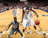 Jan. 8, 2011; Charlottesville, VA, USA;  Virginia Cavaliers center Assane Sene (5) reaches for the rebound in front of North Carolina Tar Heels forward Harrison Barnes (40) during the game at the John Paul Jones Arena. North Carolina won 62-56. Mandatory Credit: Andrew Shurtleff