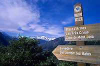 Trail signs with snowy summits in the background, Belvedere, French Alps, France.
