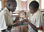 Deborah Anhiak Aboud (left) and Rose Arual Deng work together on an experiment in the chemistry lab at the Loreto Secondary School in Rumbek, South Sudan. The school is run by the Institute for the Blessed Virgin Mary--the Loreto Sisters--of Ireland.