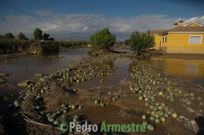 View of a flooded street covered with watermelons taken in Lorca, near Murcia, southeastern Spain, on September 30, 2012 after heavy rainfall. Ten people in total have died in Spain in the regions of Andalusia and Murcia due to flash flooding brought on by downpours. The heavy rains have also damaged homes, caused the collapse of two bridges and forced roads to close. Ten people in total have died in Spain in the regions of Andalusia and Murcia due to flash flooding brought on by downpours. The heavy rains have also damaged homes, caused the collapse of two bridges and forced roads to close. . (c) Pedro ARMESTRE