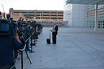 Press gather outside the Federal Courthouse in Phoenix, Arizona following Jared Lougher's first court appearance.  Loughner is charged as the shooter in an attack that left six dead and [Niumber] injured outside a Pima County Safeway store.  ..Also pictured: U.S. Attorney Pat Cunningham exits the Federal Courthouse in Phoenix, Arizona....Also pictured: A van presumably carrying defendant Jared Loughner exits the sally port at the Federal Courthouse in Phoenix, Arizona.....  Scenes from Tucson, Arizona in the days following a mass shooting that left six dead and [number] injured.  The shooter, identified as Jared Loughner, was captured at the scene and charged in federal court on January 9th, 2011.  Among the injured was democratic congresswoman Gabrielle Giffords.  The dead included a federal judge, a nine year-old girl, and several septaugenarians who had all come to see the congresswoman at one of her 'Congress on the Corner' events.