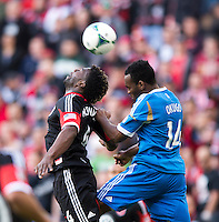 Brandon McDonald (4) of D.C. United goes up for a header with Amobi Okugo (14) of the Philadelphia Union during the game at the RFK Stadium in Washington DC.  Philadelphia defeated D.C. United, 3-2.