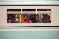 "Subway enthusiasts as well as regular travelers ride the ""Train of Many Colors"" on the Flushing line in the New York subway on their way to the World's Fair anniversary on Sunday, may 18, 2014. The train consists of vintage cars in service from 1932 to 1977 including Redbirds and the blue and white World's Fair cars. The Metropolitan Transit Authority has several of these trains for the various subway lines which they put into use for special occasions. the trains normally reside in the New York City Transit Museum in downtown Brooklyn where they can be visited every day. (© Richard B. Levine)"