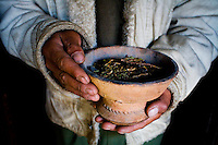 Rinchen Namgyal, aged 19, carries burning juniper around the room for the daily morning prayers in the ancient family gonpa on the roof of the 200 year old house on 3rd June 2009.. .They run a home stay program in Ulley Valley, a scattered village of only 5 houses, one school, 38 people, 4 school children, and 4 pet dogs. The village is not accessible by road. The homestay program is managed by 'Snow Leopard Conservation Organisation', an NGO that helps families in the mountains that face constant snow leopard attacks on their livestock...Leh town is 3505m above sea level, in the Indian Himalayan mountains. Multimedia travel story assignment to Leh, Ladakh with Scott Macmillan.  Photo by Suzanne Lee / For The National